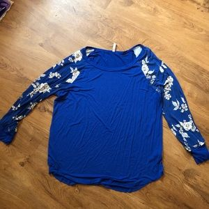 Blue long sleeve tee with floral design on sleeves